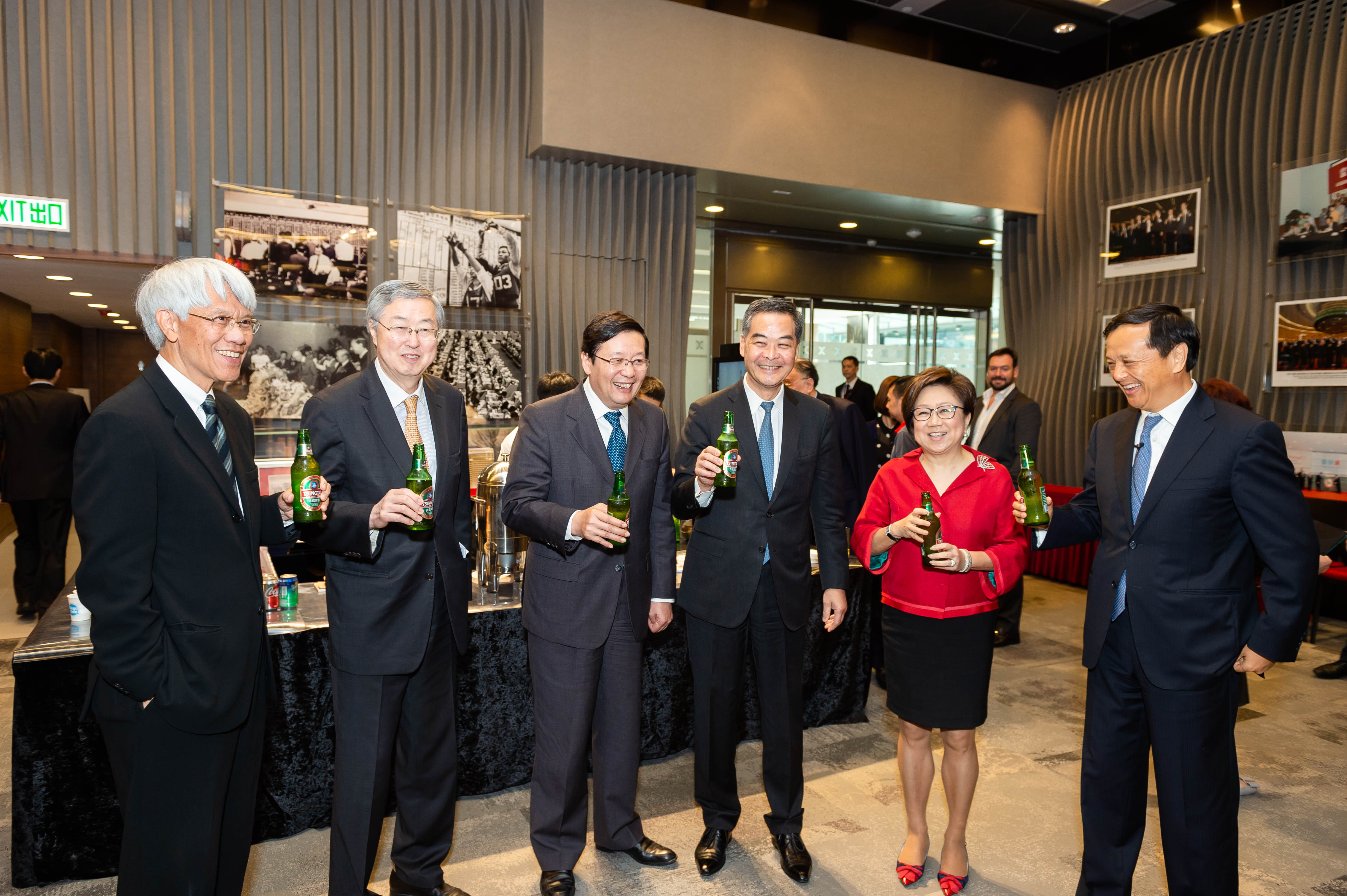 (From left) Joseph Yam, Zhou Xiaochuan, Lou Jiwei, C Y Leung, Laura Cha, and Charles Li enjoying some Tsingtao Beer to celebrate 25 years of H-share listings in Hong Kong.  Tsingtao Brewery was the first H-share company to list in Hong Kong. Its listing in 1993 was a major milestone in China's opening up.
