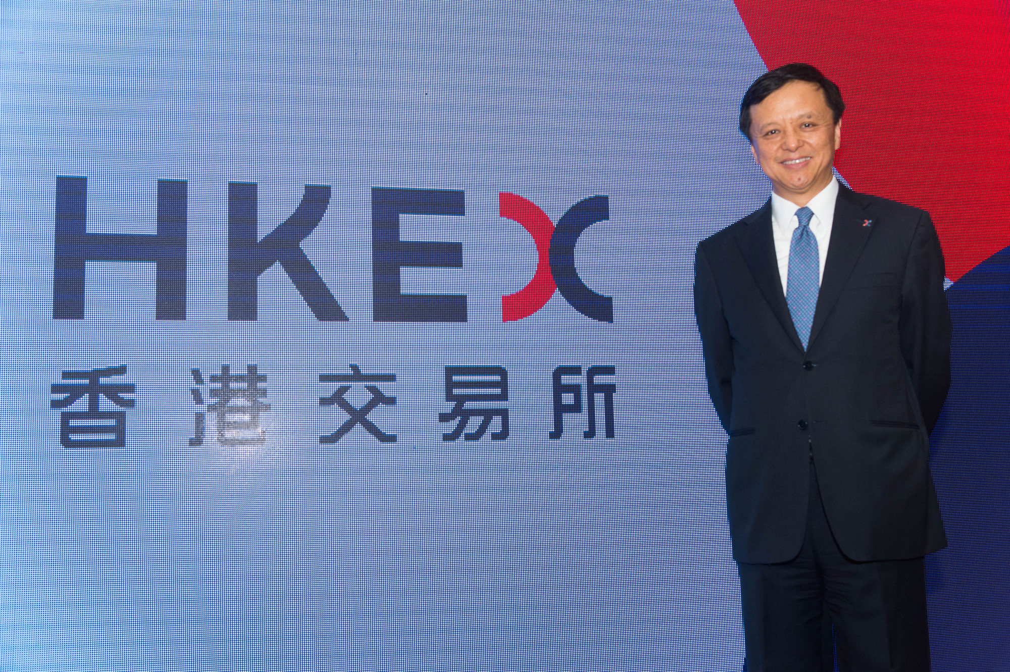 Chief Executive Charles li officially unveils HKEX's new logo. He says the new corporate identity aligns with the HKEX's newest Strategic Plan 2016-2018, which details its plans to connect China with the world.