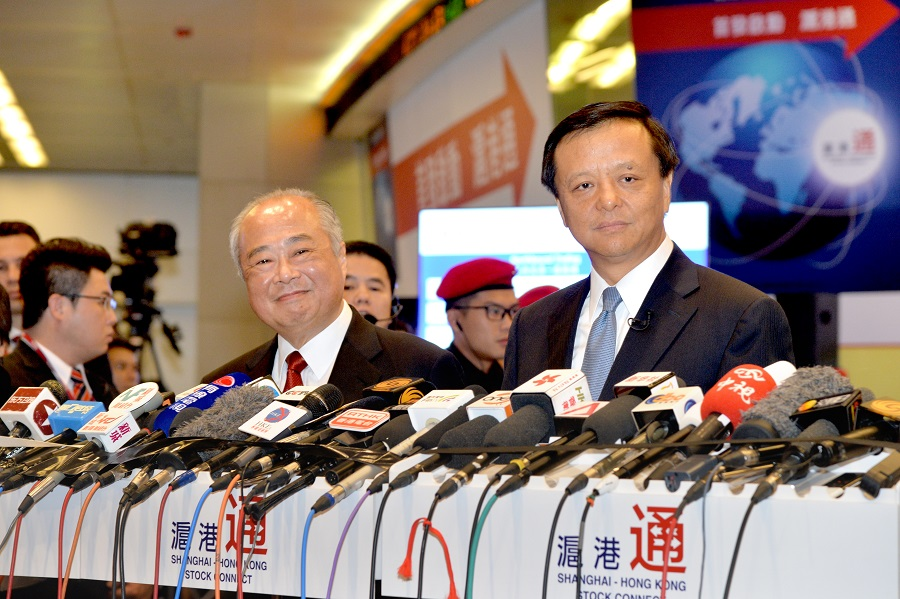 HKEX Chairman C K Chow (left) and Chief Executive Charles Li (right) talk to the media after the launch ceremony of Shanghai-Hong Kong Stock Connect on 17 November 2014.